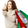 Portrait of an young woman holding several shoppingbag — Stock Photo