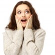 Closeup of a happy young woman surprised — Stock Photo