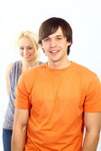 Happy smiling couple in love, over white background — Stock Photo