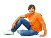 Casual young satisfied man sitting relax — Stock Photo