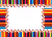 Assortment of coloured pencils with shadow on white background — Stock Photo