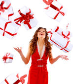 Excited attractive woman with many gift boxes and bags. — Stockfoto
