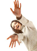 Young female gesturing with hands against white background — Stock Photo