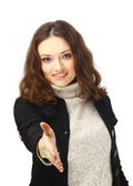 Portrait of a cute female offering you a handshake isolated over white — Stock Photo