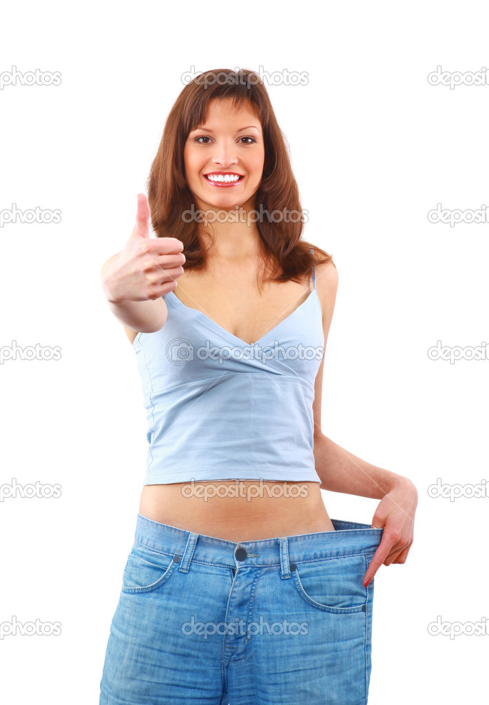 Happy young woman in old jeans pant after losing weight — Stock Photo #2535516