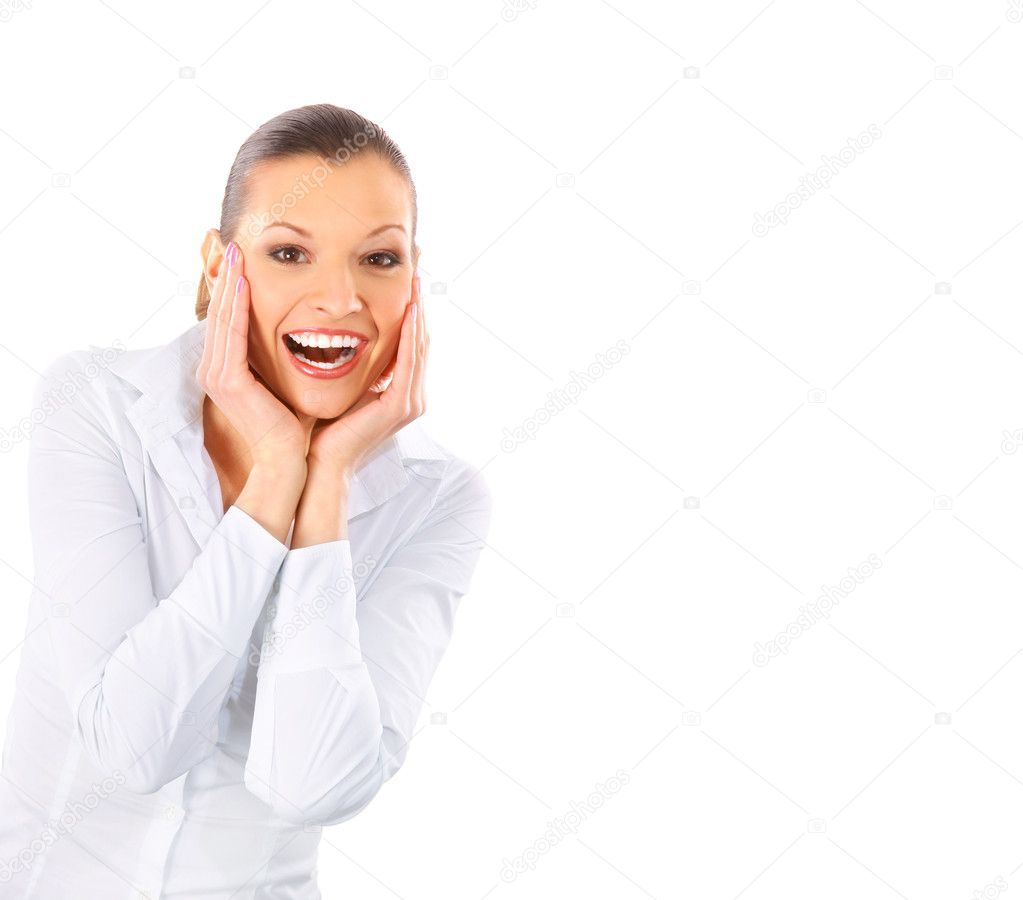 Happy surprised young girl looking at copy space over white background  Stock Photo #2535934