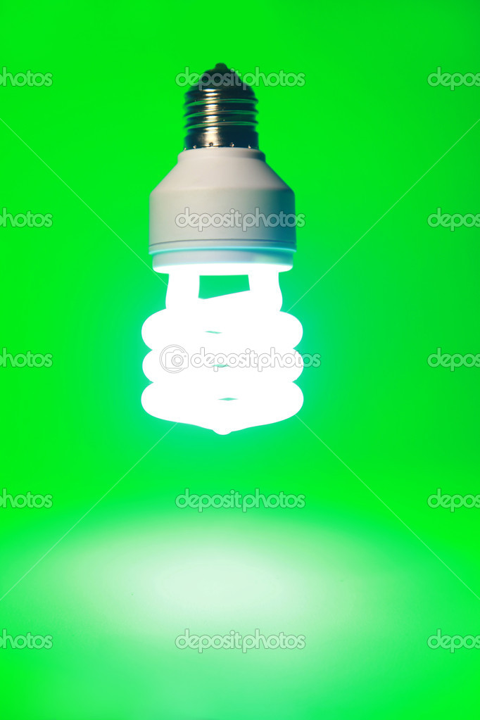 lightbulb on green background — Stock Photo #2536472