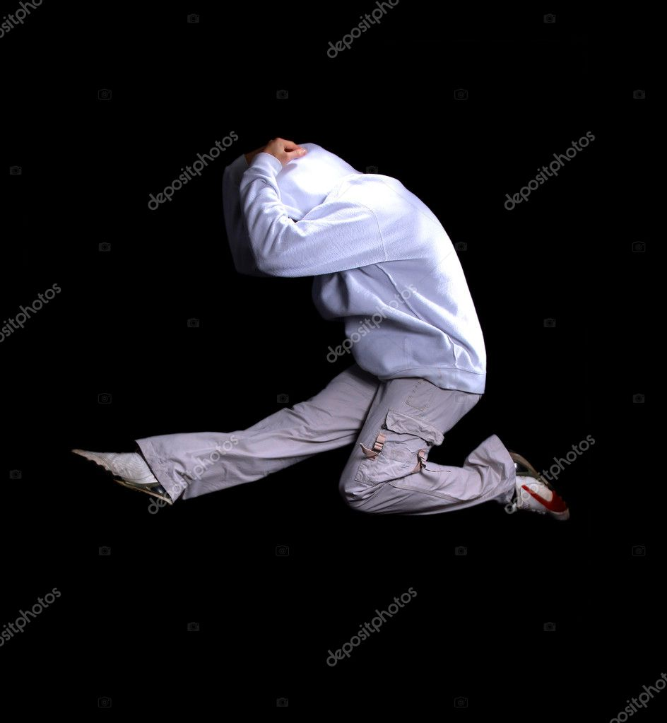 Cool looking dancer posing on a black background — Stock Photo #2538891