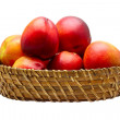 Royalty-Free Stock Photo: Basket full of fresh peaches isolated on