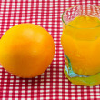 Glass of orange juice and fruit — Stock Photo