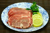 Slices of fresh pork meat — Stock Photo