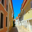 Stock Photo: Narrow street in Lisbon, Portugal
