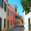 A narrow street in Lisbon, Portugal - Stock Photo