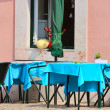 Stockfoto: Empty tables in street cafe