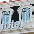 Royalty-Free Stock Photo: Hotel Sign and Windows