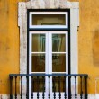 Window in old yellow wall — Stock Photo