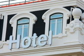 Hotel Sign and Windows — Stock Photo