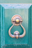 An old metal door handle knocker — Stock Photo