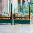 Empty tables in street cafe — Stock Photo #1150323