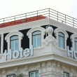 Stock Photo: Hotel Sign and Windows