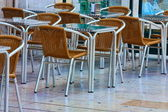 Empty tables in street cafe — Stock Photo
