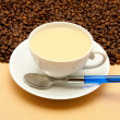 Stock Photo: White cup of coffee and coffee beans