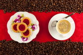 Coffee cup from above with coffee beans — Stock Photo