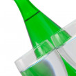 Green bottle and glass of water — Stock Photo