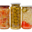 Glass jars with marinated vegetables — Stock Photo