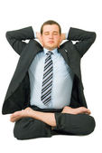 Businessman meditating in yoga style — Stock Photo