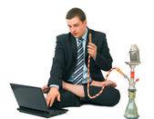 Businessman smoke hookah isolated — Stock Photo