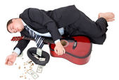 Businessman lies with guitar — Stock Photo