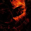 Women devil in fire — Stock Photo