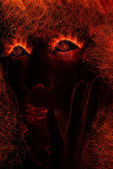 Woman face made of fire — Stock Photo