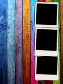 Three Blank Photos on Wooden Background — Stock Photo