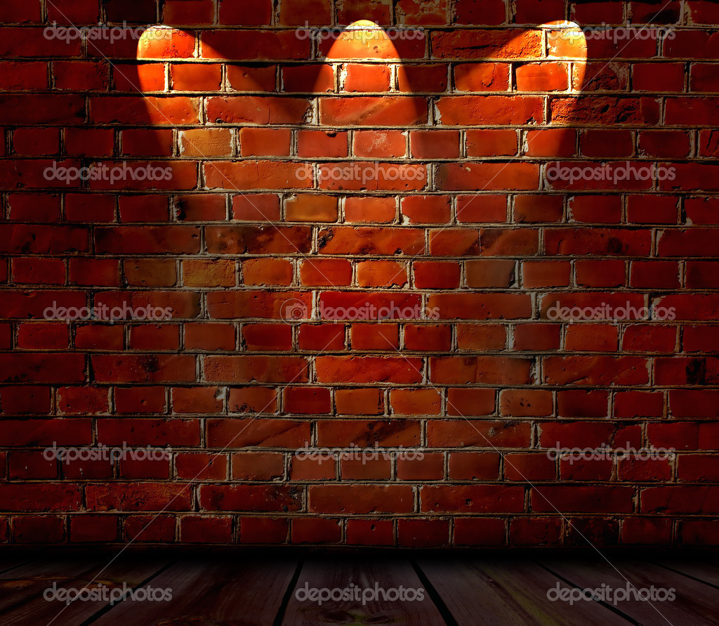 An empty room with a spotlit red brick wall was a background  — Foto Stock #1158352