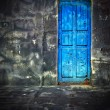 Dark Vintage Room with Blue Wooden Door - Stock Photo