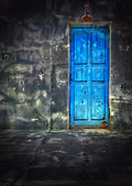 Dark Vintage Room with Blue Wooden Door — Stock Photo