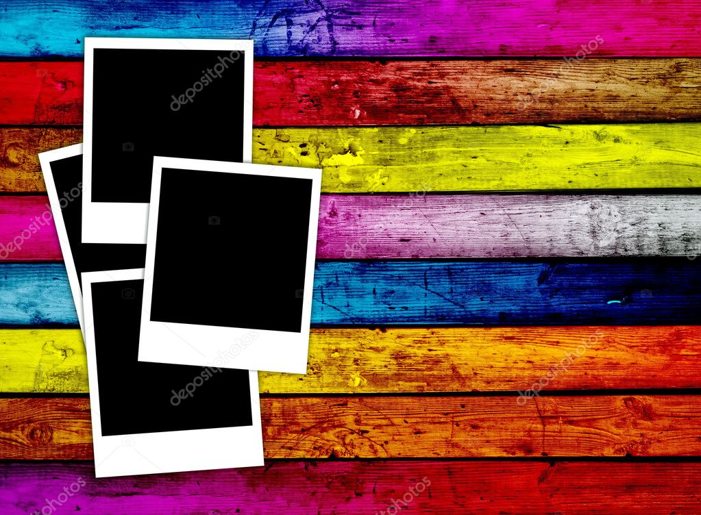 Four blank Instant photos on colorful wood background — Stock Photo #1170788