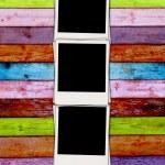Three Blank Photos on Wood Background — Stock Photo #1277225