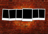 Six Blank Photos on Brick Background — Stock Photo