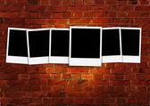 Six Blank Photos on Brick Background — Stock Photo