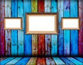 Three Blank Frames in Wooden Room — Stock Photo