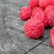 Stock Photo: Red Raspberries on Tree Stump