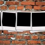 Photos On Brick Wall — Stock Photo