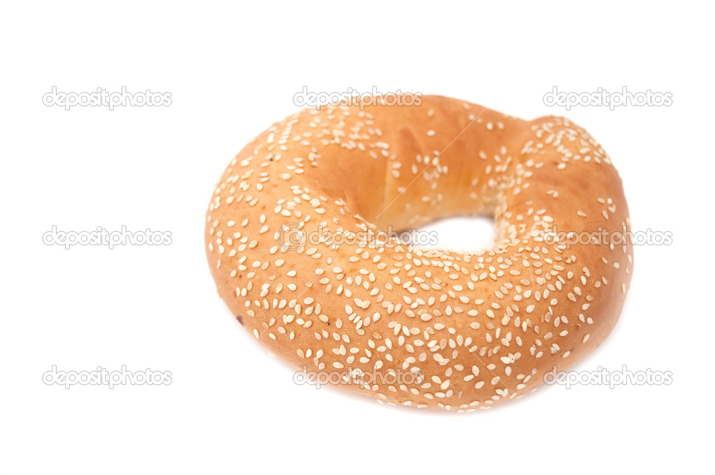 A freshly baked bagel with sesame seeds isolated on a white background — Stock Photo #2429089