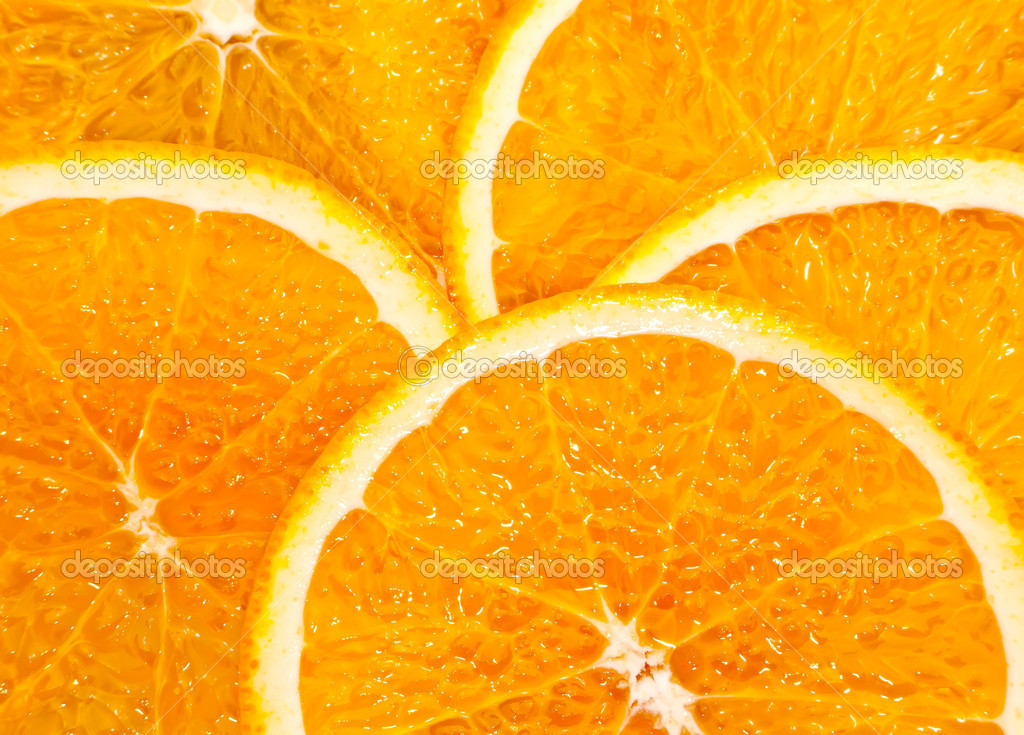 Juicy slices of an orange (can be used as a background) — Stock Photo #2429225
