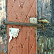 Torn Nailed Up Door - Stock Photo