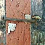 Torn Nailed Up Door — Stock Photo