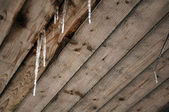 Icicles on Wooden Roof — Stock Photo